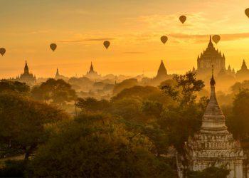 Balloons adorn the sky as the sun rises over Bagan