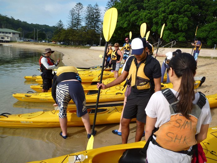 Preparing the kayaks to go