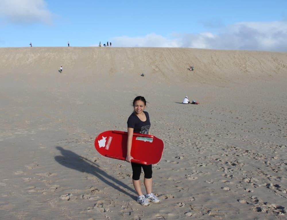 Getting ready to go sandboarding