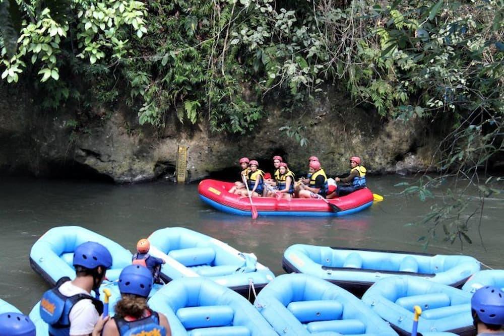 A raft drifts by
