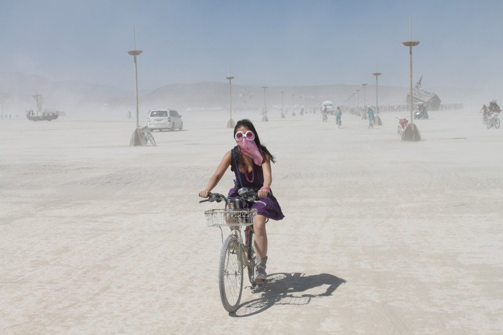 Lisette riding on the open playa