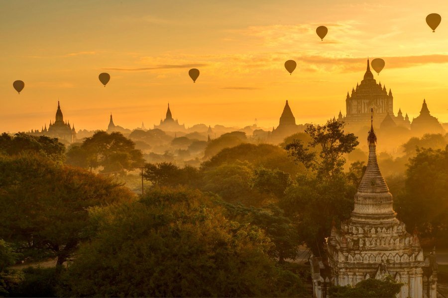Balloons adorn the sky as the sun rises over Bagan