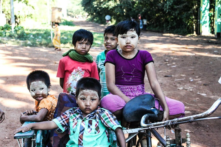 burmese kids on a bike