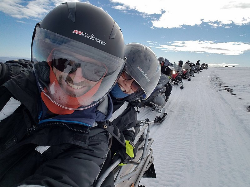A convoy of snowmobiles