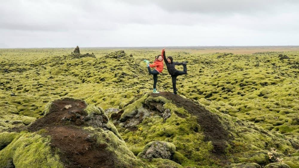 Posing on a mossy lava field